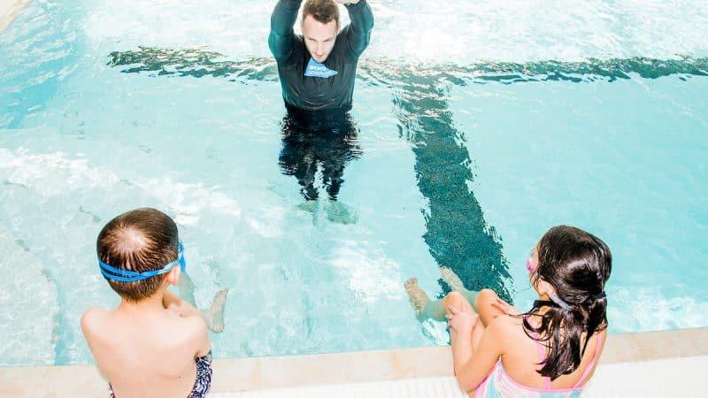 Coach teaching in water